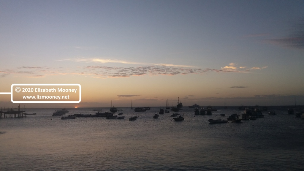 Sunset over the sea with boats in the distance, Galapagos